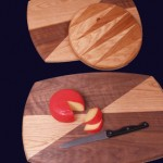 "Cutting Boards: 2006 Round-Cherry, Hickory 10"" dia. $70 Large Squircle-Walnut, Red Oak 17"" long, 12"" wide $55 Small Squircle-Walnut, Red Oak 15"" long, 11"" wide $50"