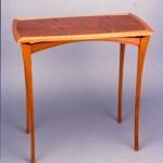 """Mahogany Side Table: 1988 Mahogany, Quilted Mahogany Veneer, Ebony Stringing 28"""" tall, 29"""" wide, 17"""" deep $950"""